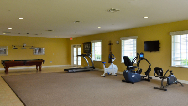 Fitness caenter with exercise equipment in The Terrace at Priceville