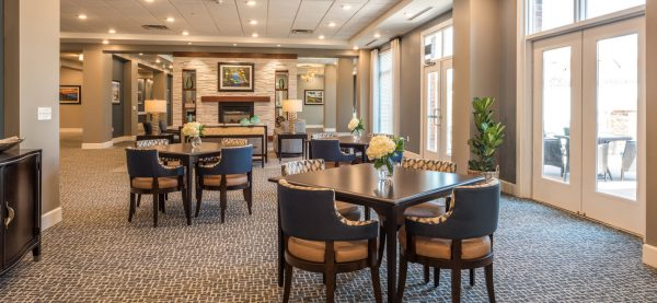 Dining room with plentiful seating and fireplace at Windsor Run