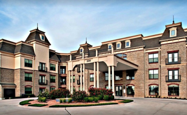 Front view of exterior building gfeaturing circular driveway and covered entrance to Discovery Village At Castle Hills