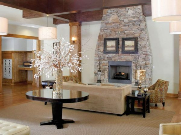 Community living area with sofas and fireplace at Discovery Village At Sugarloaf