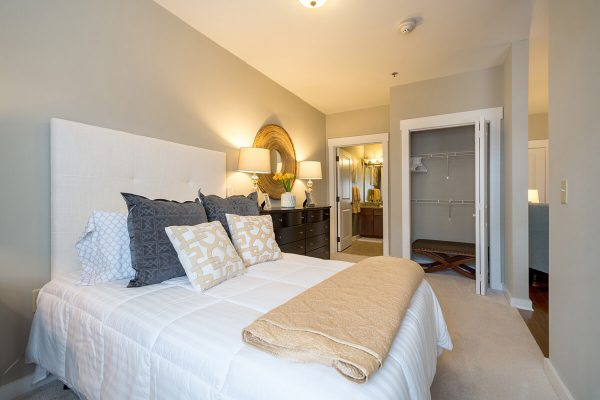 Example of a resident bedroom with large closet at Discovery Village At Sugarloaf