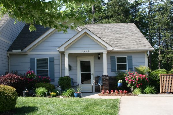 Charming blue home exterior at The Glens at Birkdale Commons