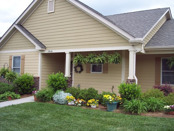 Exterior view of home surrounded by plants at The Glens at Birkdale Commons