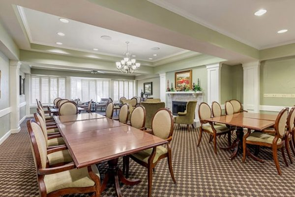 Dining room and fireplace in The Watermark at Broadway Cityview