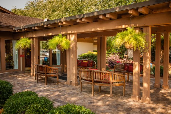 Park benches and a covered walkway leading into The Brennity at Fairhope
