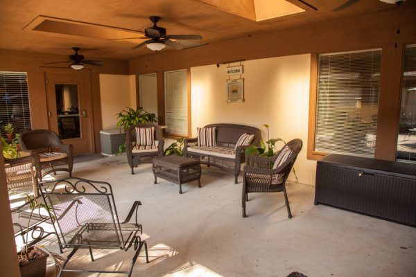 The Brennity at Fairhope resident patio and resident seating area