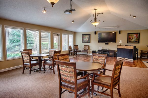 TV and game room with wooden dance floor in The Brennity at Fairhope
