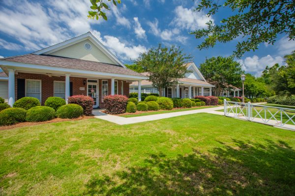 The Brennity at Fairhope cottage home building fronts