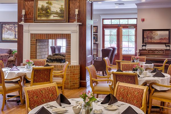 Open fireplace in the The Brennity at Fairhope community dining room