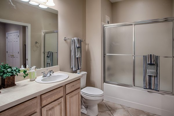 The Brennity at Fairhope independent living room with shower tub combo