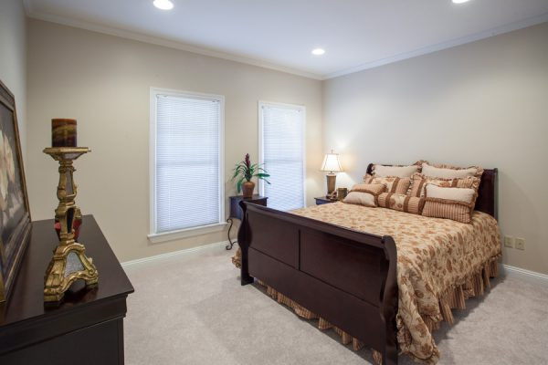 Model bedroom in a The Brennity at Fairhope independent living cottage home