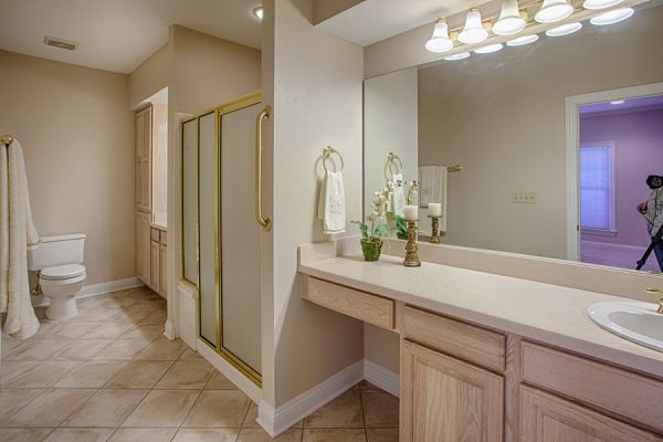 Model bathroom in a The Brennity at Fairhope cottage home