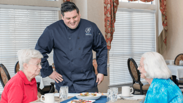 The Gardens of Scottsdale chef talking with two senior women diners