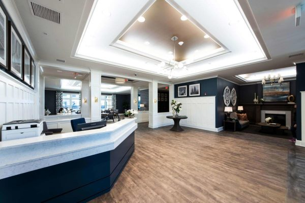 Pathway Heartis Village North Shore front desk and lobby ares with raised ceiling and hardwood floors