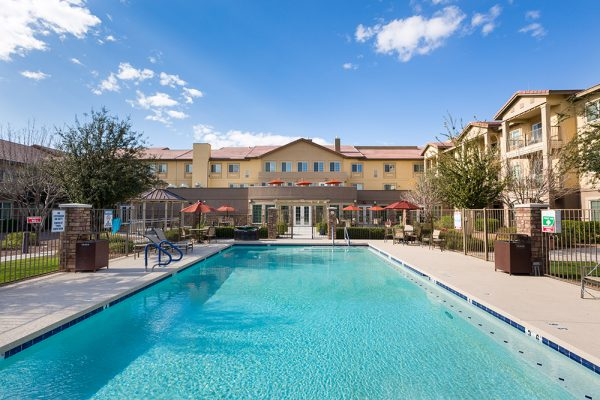 Outdoor swimming pool and lounge chairs at Palos Verdes Senior Living