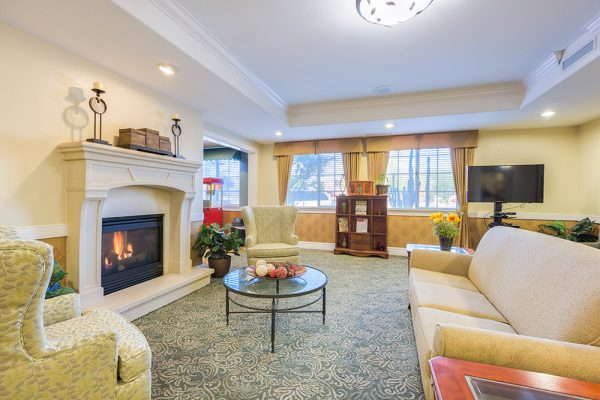 Mountain Park Senior Living community living room with fireplace