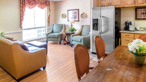 The Gardens of Sun City living room and kitchen area
