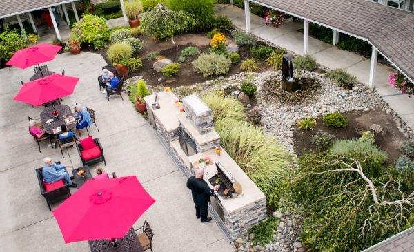 Aegis Living Issaquah aerial view of courtyard and barbecue area