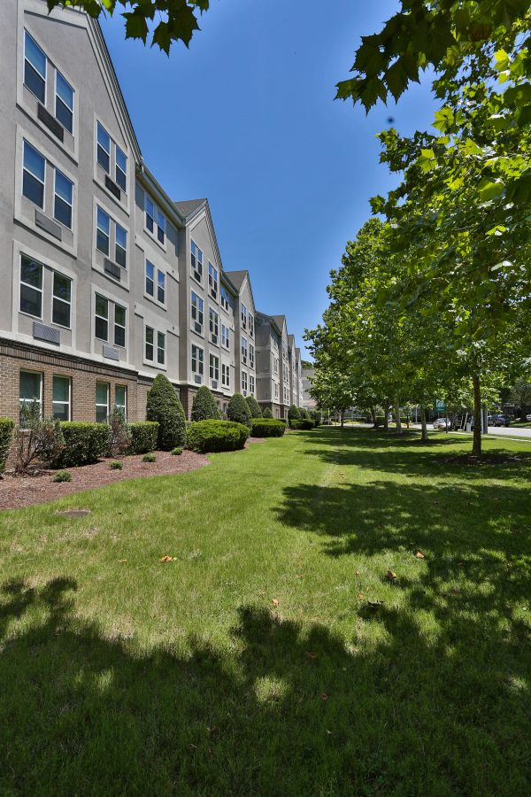 The grounds and green spaces of Cromwell House Apartments