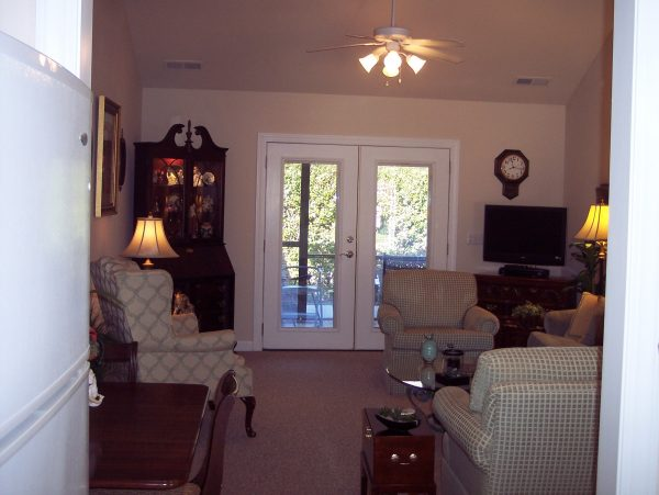 The Glens at Birkdale Commons model living room with glass french doors