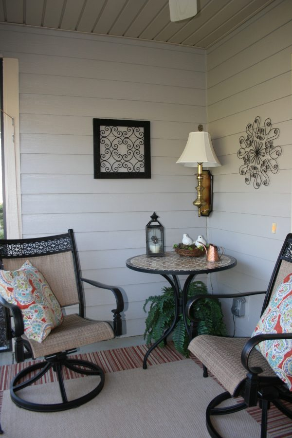 Porch with small table and two chairs at The Glens at Birkdale Commons