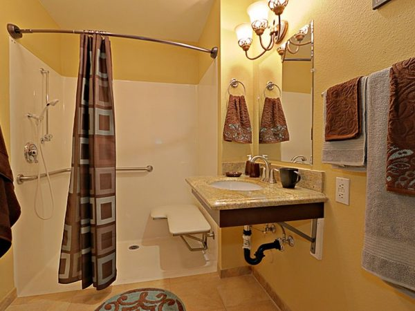 Pacifica Senior Living Peoria model apartment bathroom with walk in shower and grab bar