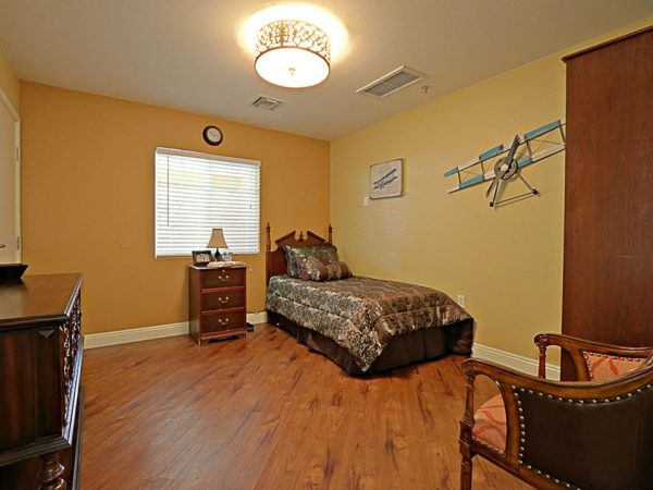 Model bedroom with single bed in Pacifica Senior Living Peoria