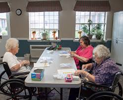 Peak Resources Brookshire residents doing crafts at a long table