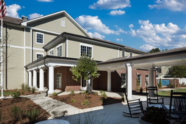 Outdoor seating and covered walkways at River Highlands