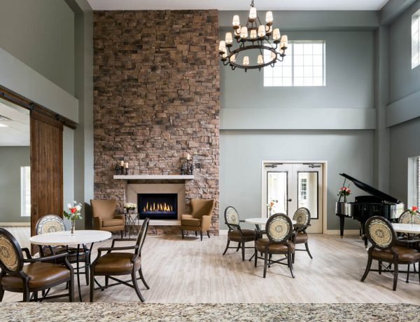Towering stone fireplace and resident gathering spaces in River Highlands