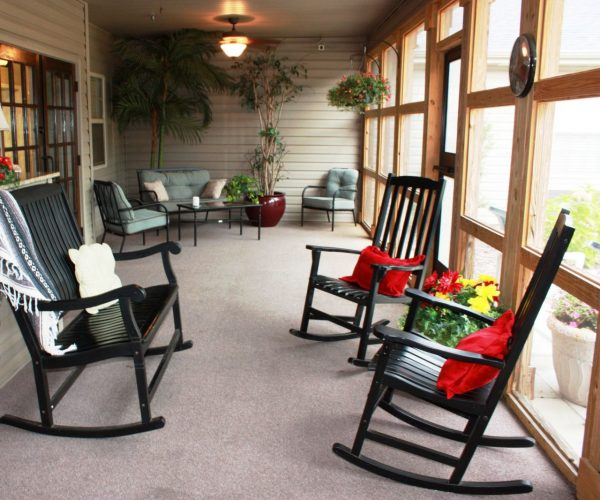 Village at Cook Springs screened porch and rocking chairs