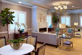 The Bristal Assisted Living at Englewood resident common living room with comfortable seating around large fireplace