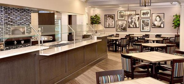 The Bristal Assisted Living at Englewood dining room with long glass covered buffet and seating for residents