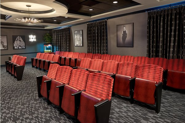 The Bristal Assisted Living at Garden City movie theater with fold down seats and dark drapes on the wall