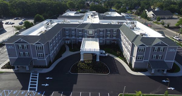 Aerial view of the front courtyard and entrance to The Bristal Assisted Living at West Babylon