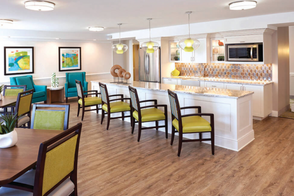 The Bristal Assisted Living at Westbury coomunity kitchen with breakfast bar and tables