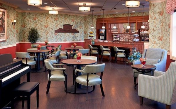 The Bristal Assisted Living at Woodcliff Lake lounge with bar area and cocktail tables