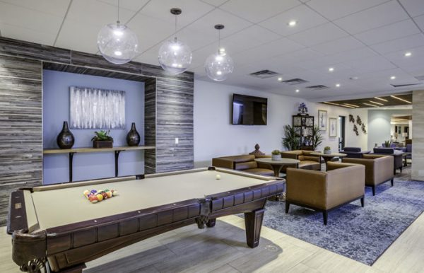The Palazzo community game room with tan felt covered billiards table