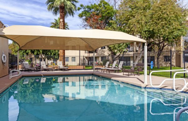 Outdoor swimming pool with large sunshade over the shallow end at The Palazzo