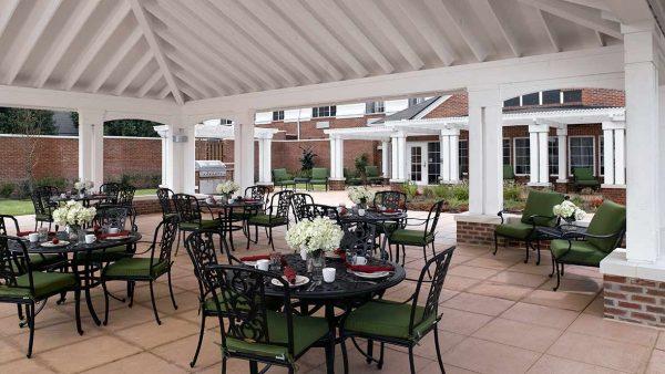 Covered patio dining area at Atria Grapevine