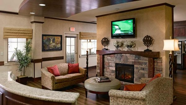 Stone fireplace and seating area in Atria Grapevine