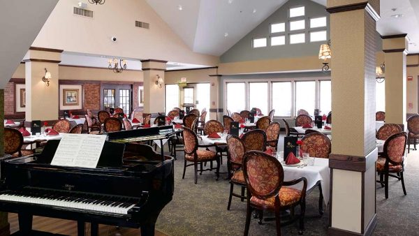 Atria Grapevine community dining room with a black grand piano