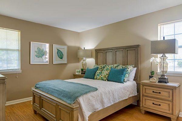 Model bedroom in an apartment home at Brookdale Cedar Springs