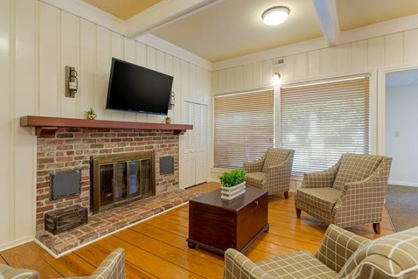 Common area with seating and fireplace in Brookdale Cedar Springs