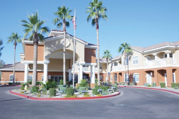 Brookdale North Scottsdale building front and entrance with tall palm trees in front