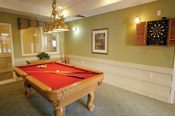 Brookdale North Scottsdale billiards room with a red felt pool table