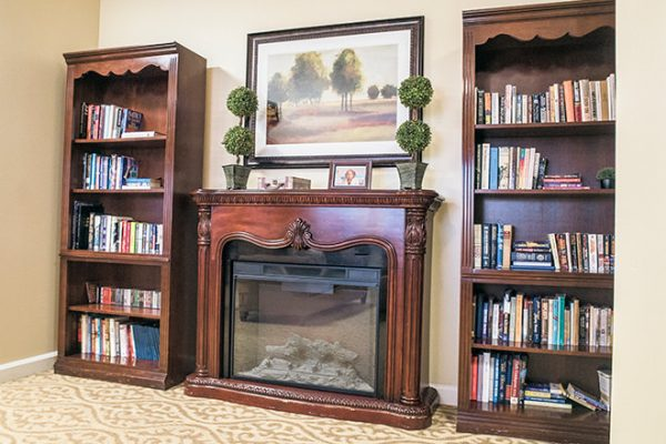 Fireplace and bookshelves in the Brookdale Tanglewood Oaks library
