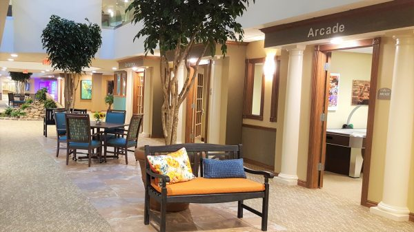 Common area featuring seating and indoor trees at Cahaba Ridge Retirement Community