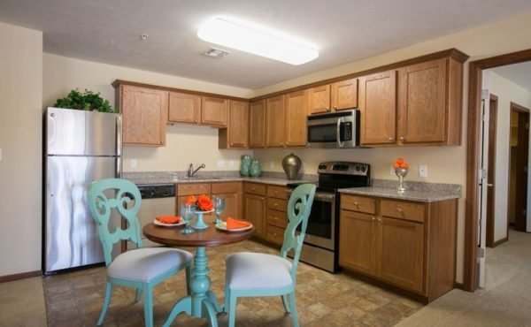 Capital Oaks Retirement kitchen area with dining room table for two