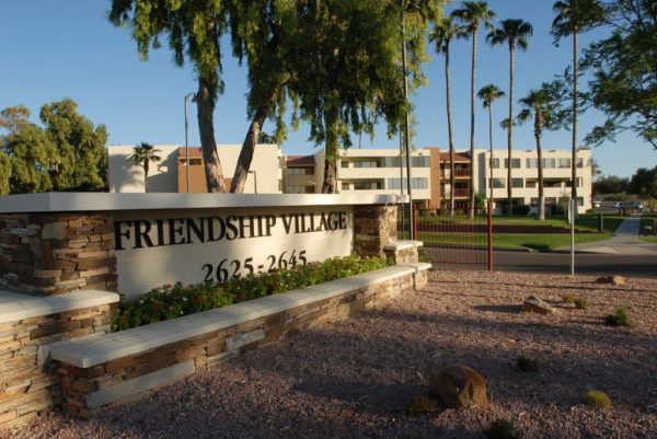 Entrance sign and building of Friendship Village Tempe